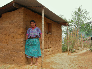 Benita Patzan outside her adobe home in Pachay las Lomas, Guatemala