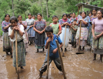 Mayan students providing community service