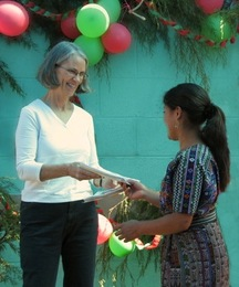 Marilee receiving a thank you card from a scholarship student